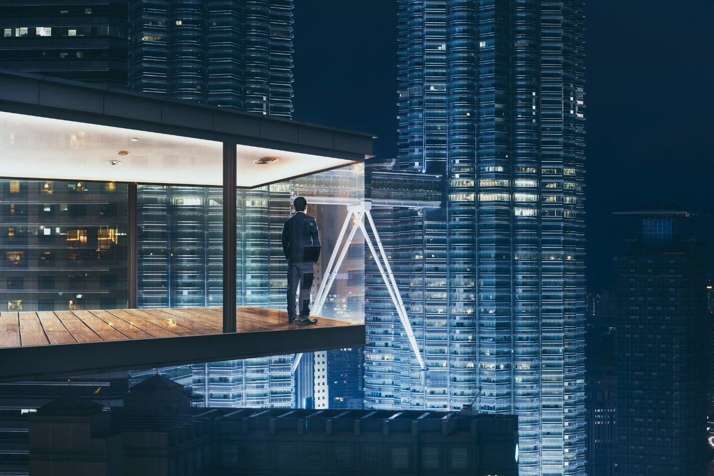 Man standing in a skyscraper