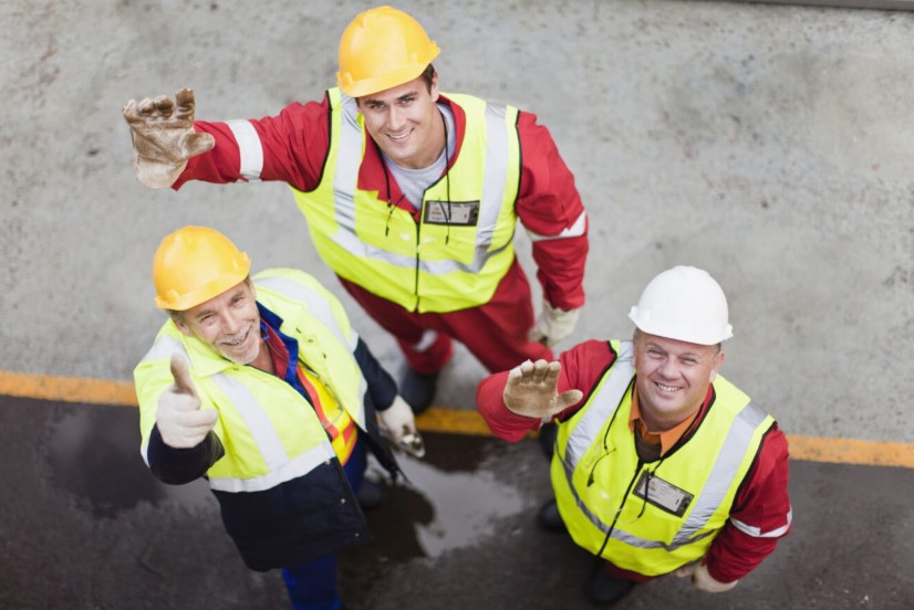 Three generations of construction workers on site