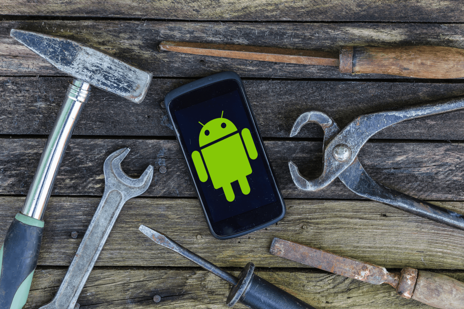 An android smartphone and hand tools