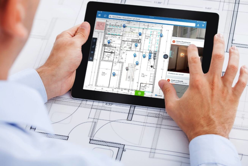 A planner using a tablet with PlanRadar